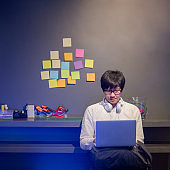 Asian man student learning online course at home