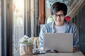 Asian man using laptop computer for remote working