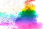 Colorful background of pastel powder explosion.Rainbow color dust splash on white background.