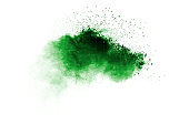 Green color sand explosion cloud on white background. Green dust splash.