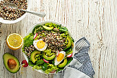 Green salad meal with quinoa, egg and avocado