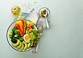 Salad meal with mixed fresh vegetables, avocado and egg