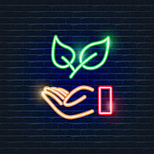 Leaf in hand neon icon. Ecology Vector trendy colored symbols. Eco friendly concept. Glowing illustration for design.