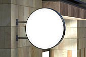 Round signboard or signage on the marble wall with blank luminescent sign mock up. Side view.