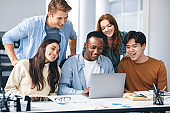Group of international people using laptop and smiling