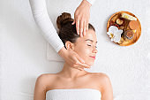 Aromatherapy and head massage for relaxed young woman