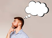 Side view of pensive young guy with empty thought cloud on light background, space for your design