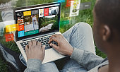 Relaxed black man with laptop searching web in green park. Collage with internet site on screen and functional icons