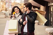 Couple with credit card near city center