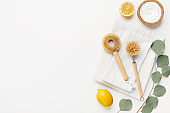 Composition with eco-friendly natural cleaners on white background