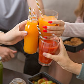 Teens clink glasses with detox cocktails to boost immunity