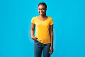 African Millennial Woman With Brackets Smiling Standing Over Blue Background
