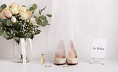 Bride accessories with bouquet and high heel shoes