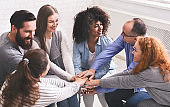 Group Of Happy People Joining Hands At Therapy Session
