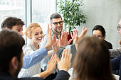 Team inspiration concept. Colleagues giving high five