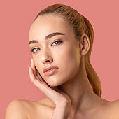 Pretty Girl With Perfect Makeup Touching Face On Pink Background