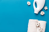 White plastic washing conditioner, cotton towel and cotton flowers
