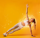Collage with attractive sportswoman doing side plank exercise on orange background. Empty space