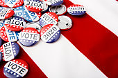 Variety Of Presidential Election Buttons on American flag