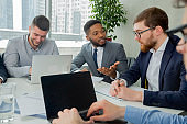 Multiracial business team having discussion in office