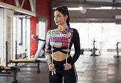 Lovely lady with skipping rope in gym