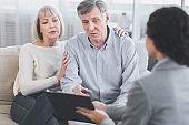 Senior couple talking to their financial advisor