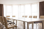 Meeting room with panoramic window. Table and chairs