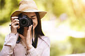 Photography Lover. Young Asian Woman Taking Shot Outdoors With Modern Camera