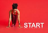 Black Female Athlete In Starting Position Before Run With Lettering Start