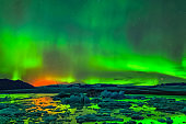 Aurora borealis in night northern sky. Ionization of air particl