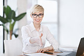 Lady Stretching Hand For Handshake Greeting Sitting At Workplace