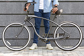 Unrecognizable Afro Man Holding Bicycle With Stylish Design