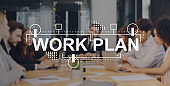 Work plan written on group of people discussing work