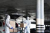 Virologists in coronavirus hazmats delivering goods, products
