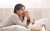 Dad closing his daughter eyes while watching movie