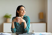 Entrepreneur Woman Smiling Having Coffee At Workplace Sitting In Office