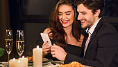 Lovely young couple looking at smartphone