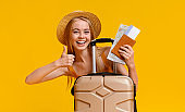 Travel For Teens. Happy Girl With Tickets And Suitcase Showing Thumb Up