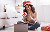 Black Woman Opening Present Box At Home