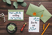 Wedding postcards or invitations, wedding rings and green envelopes