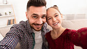 Father and daughter making selfie on phone