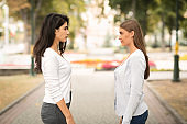 Two Girls Friends Having Conflict Standing Outdoors After Quarrel