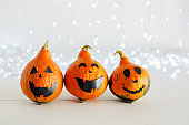 jack-o'-lantern on white background with lights. Happy Halloween party invitation, celebration. Halloween decorations concept. Copy space.
