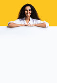 Free Place For Ad. Positive Lady Leaning On Blank White Advertisement Board