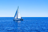Yacht sailing on opened sea. Sailing  boat in Mediterranean sea.