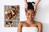 Relaxed african girl having head massage over white