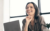 Portrait of happy woman looking aside at office
