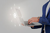 Business man using laptop, cyber security concept