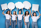 Diverse Girls Holding Empty Speech Bubbles Above Heads, Studio Shot