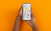 African American girl holding cellphone with map and restaurant navigation pointers, orange background. Collage